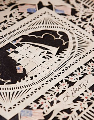 close up of a detailed paper cutting of a ship