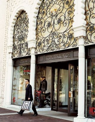 front of fancy department store with arches and iron detailing