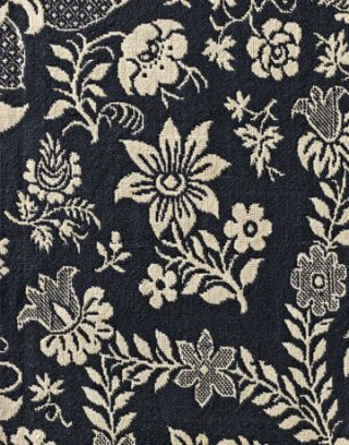 navy blue fabric with white floral embroidery