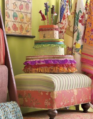 cake made of ribbons and trim on top of a colorful ottoman