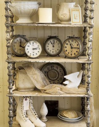 cream colored antiques and clocks on a shelf