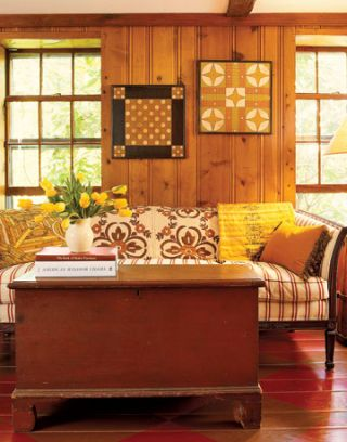 room with patterned couch and checkered floor
