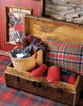 small wicker suitcase with plaid pillow and thermos and slippers