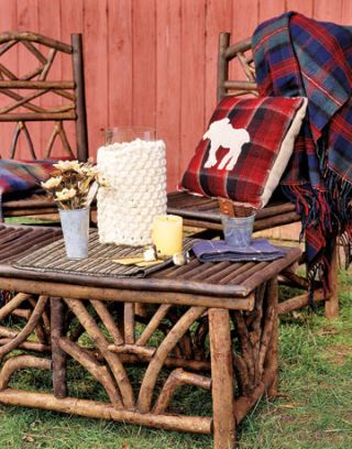 outdoor twig furniture with tartan throws and pillow