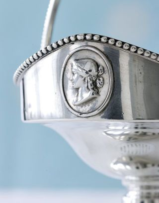 silver vase with detail of womans profile