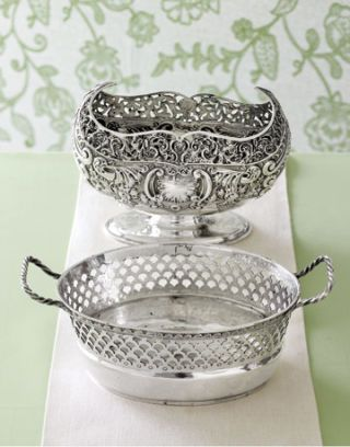 elaborately designed silver dishes