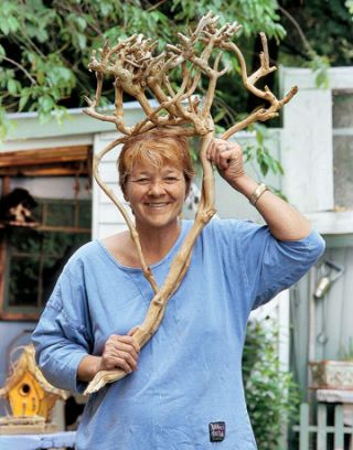 woman holding a tree branch like antlers
