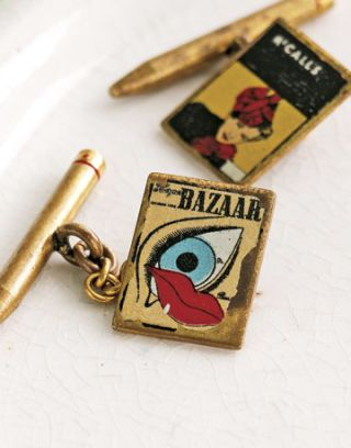 gold cuff links with images of magazine covers