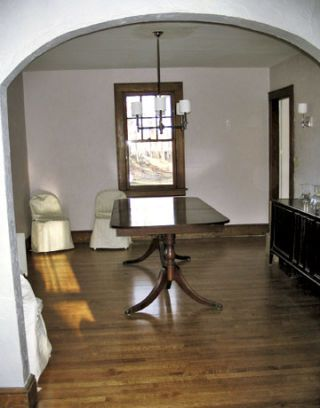 empty dining room with wood floor and table