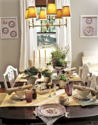 dark wood dining table with table settings and chandelier