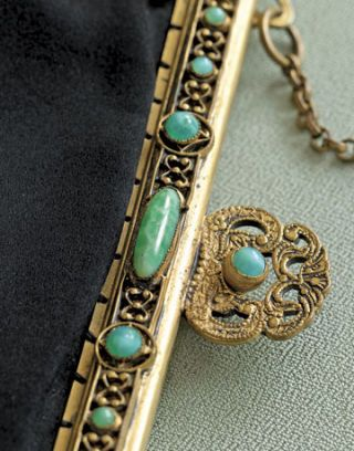 close up of gold and jade clasp on a purse