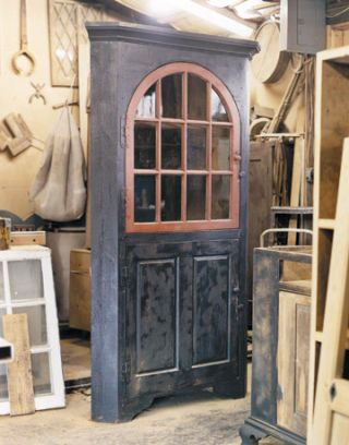 a wooden door with farmhouse window within a woodshop