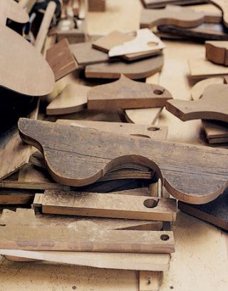 various wood templates piled up on a table