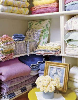 linen closet with colorful linens