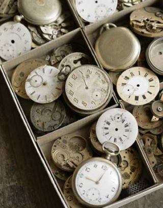 antique clock parts in boxes