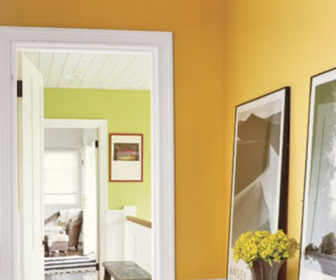 yellow orange hallway with white accents