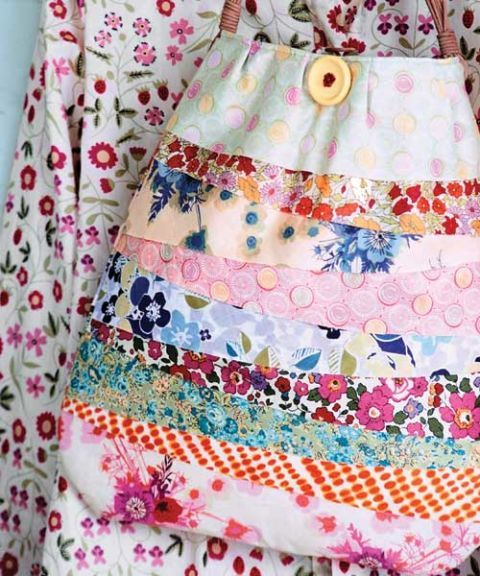 a multicolored and patterned bag with different floral designs hanging near floral blouse