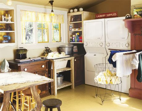 Laundry Room with Two Stackable Washer Dryer Units
