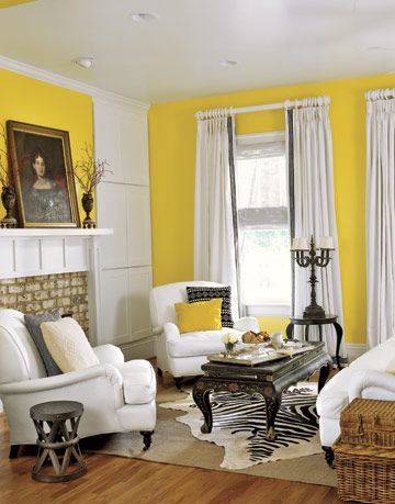 Living Room With Yellow Walls and Black and White Furniture