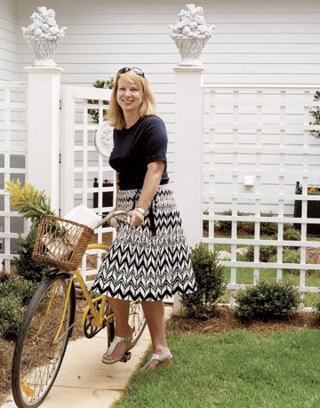 Designer Ann Nicholson outside her now-cheery newly-renovated North Carolina Home