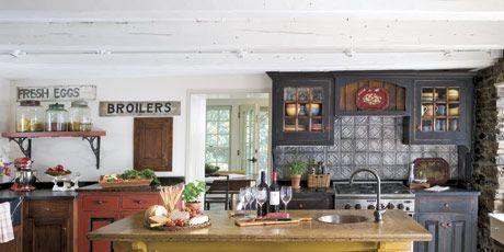 kitchen with yellow island and tile backsplash