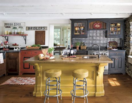 kitchen with yellow island and tile backsplash