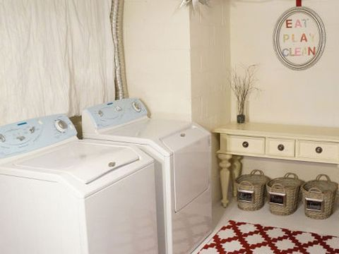 Property, Room, Home accessories, Major appliance, Washing machine, Cabinetry, Laundry room, Home appliance, Wall clock,