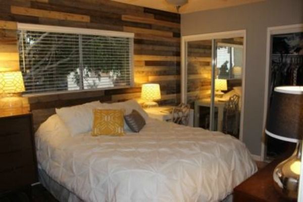 how to install a diy wooden pallet wall - easy, inexpensive bedroom
