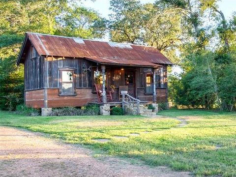 Look inside this tiny texas lake home tiny houses for sale for Custom cottages for sale