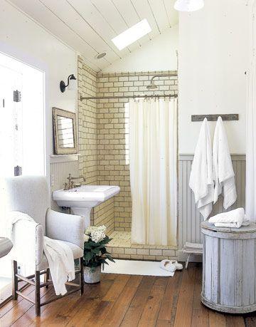 White Bathroom With Wood Floor