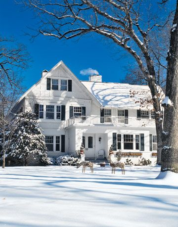 white two story house blanketed in snow
