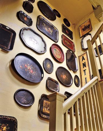 tole trays displayed above the stairs