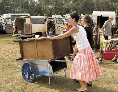 woman wheeling a dresser on a cart