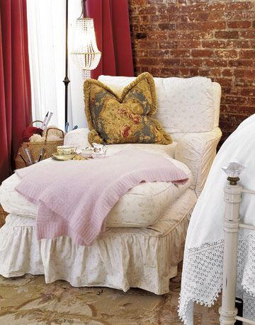 soft white chaise with pillow and throw