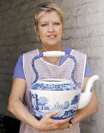 woman holding large spode watering pitcher