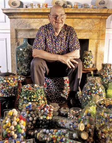 Bert Cohen with Some of His Marble Collection