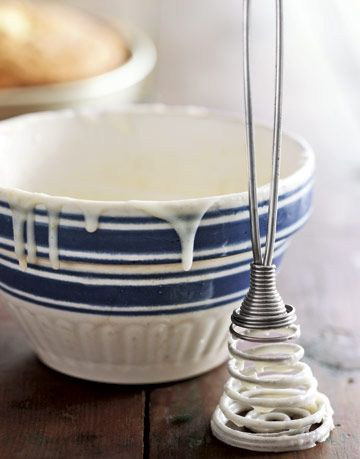 blue and white bowl with white icing dripping down the sides