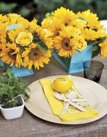 table setting with lemon place cards and sunflowers