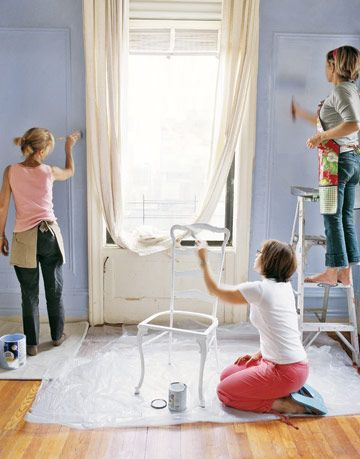 women painting a room