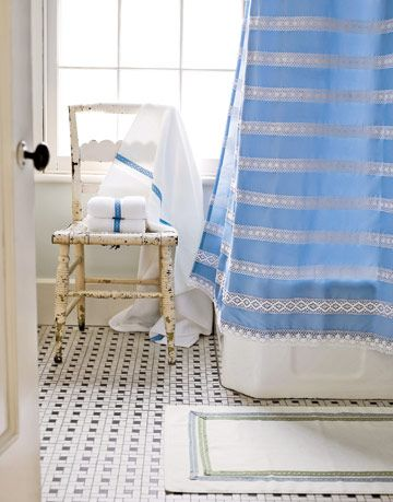 bathroom with crochet striped shower curtain and striped towels