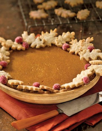 pumpkin pie with pastry leaves and sugar coated cranberries