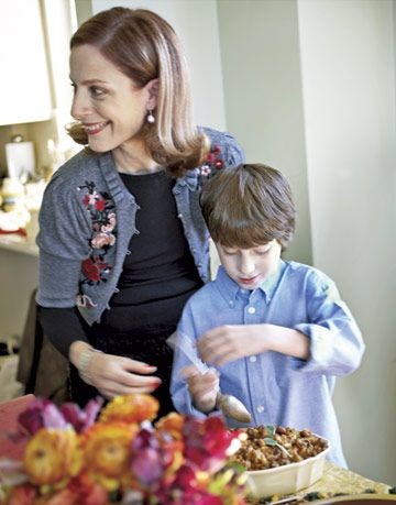 woman and her son preparing food