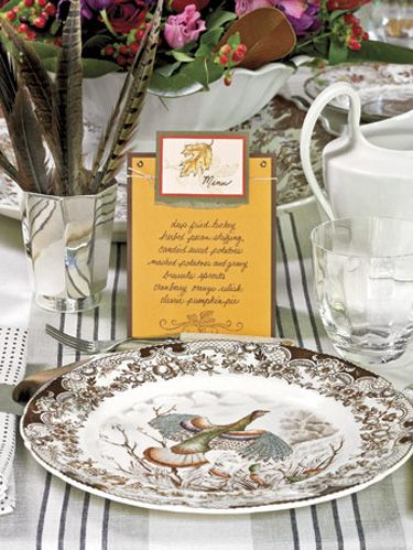 dish with a bird design and homemade invitation