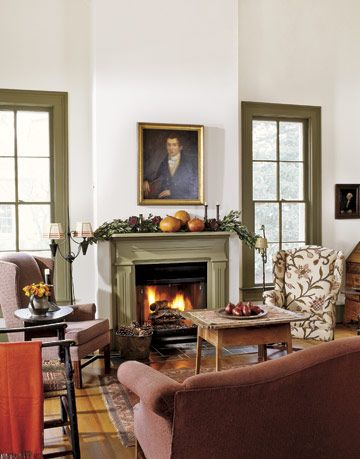 white living room with green trim windows and fireplace