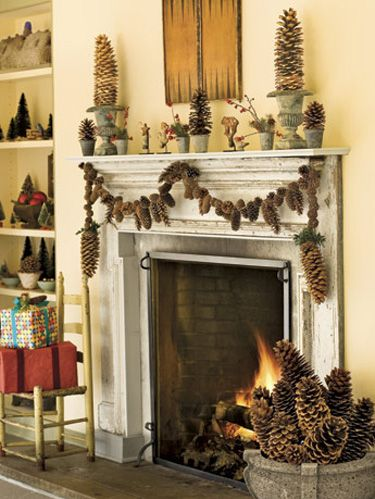 fireplace decorated with pinecones
