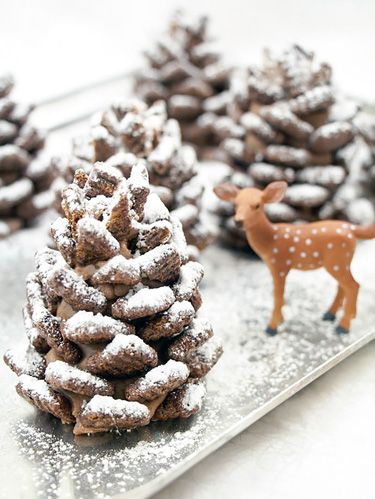image courtesy of handmade charlotte edible chocolate pinecone centerpiece - Homemade Pine Cone Christmas Decorations