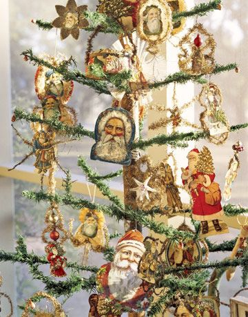 antique paper santa ornaments on a tree