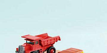 toy trucks and a van on wooden blocks