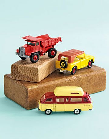 toy trucks and a van on wooden blocks