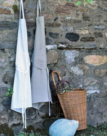 White and gray linen aprons